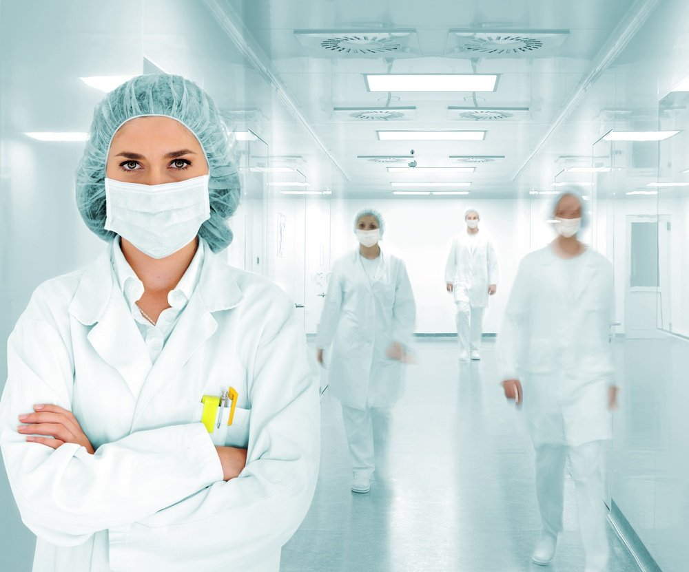 Scientists team at modern hospital lab lead by a woman doctor